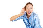 Woman listening to someone's conversation — Stock Photo
