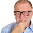 Man with finger in mouth — Stock Photo #43998523