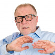 Mature man looking scared — Stockfoto