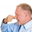 Mature man pinching nose — Foto Stock
