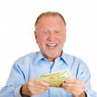 Mature man holding money dollar bills in hand — Stock Photo