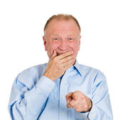 Man pointing with finger at someone and laughing — Stock Photo