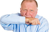 Man biting arm in neurotic nervous manner — Stock Photo