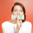 Woman with twenty dollar bill taped to mouth — Stock Photo