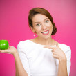 Woman pointing at yellow apple — Stock Photo #44000363