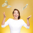 Young woman trying to catch dollar bills in air — Stock Photo