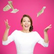Young woman trying to catch dollar bills in air — Stock Photo #44000481
