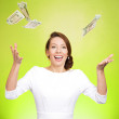 Young woman trying to catch dollar bills in air — Stock Photo #44000485
