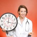 Doctor holding clock and pills — Zdjęcie stockowe #44000953