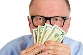 Man eyes above dollar notes — Stock Photo