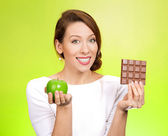 Woman offering apple or chocolate — Stock Photo