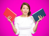 Woman deciding which book  to choose — Stock Photo
