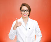 Woman health care professional showing thumbs up sign — Stock Photo