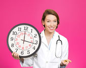 Doctor holding clock and pills — Foto de Stock