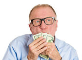 Mature man kissing dollar banknotes — Stock Photo