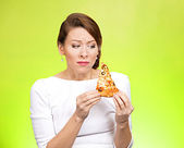 Young woman holding fatty pizza — Stock Photo