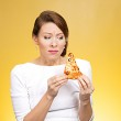 Young woman holding pizza — Stock Photo