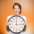 Happy woman holding wall clock — Stok fotoğraf