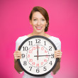Happy woman holding wall clock — 图库照片