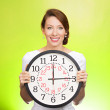 Happy woman holding wall clock — Stock Photo