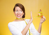 Woman holding pizza with measuring tape around — Stock Photo