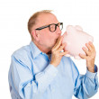 Old man kissing piggy bank — Stock Photo #44459981