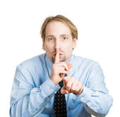 Shh. Man, pointing at someone asking to be quiet — Stock Photo