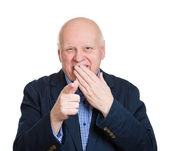 Old man laughing at someone — Stock Photo