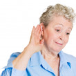 Old woman eavesdropping — Stock Photo