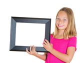 Girl displaying frame — Foto Stock