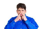 Man pinching his nose — Stock Photo