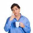 Man holding coffee and thinking — Stock Photo