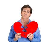 Upset man with broken heart — Stock Photo