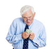 Greedy old man — Stock Photo