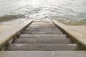 Steps leading into sea. — Stockfoto