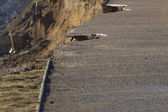 February 14 Storm Damage 2014, holes gauged out of tarmac asphal — Stock Photo
