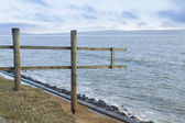 February 14 Storm Damage 2014, wooden fence suspended where clif — Stock Photo