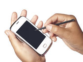 Holding Smartphone with Digitized Pen in Hand — Stock Photo