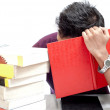 Young Student Hiding His Face with Book — Stock Photo #29816899