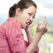 Woman Expressing Displeasure with Cellphone — Stock Photo