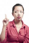 Kobieta wskazując palcem wskazującym górę — Zdjęcie stockowe