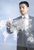 Young Businessman Pointing on Map — Stock Photo