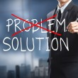 Businessman drawing and crossing out problem and finding the solution — Stock Photo #35706055
