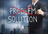 Businessman drawing and crossing out problem and finding the solution — 图库照片