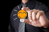 Businessman hand show Light bulb with smile icon — Stock Photo