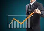Businessman drawing a rising arrow, Business growth concept — Stock Photo