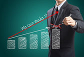 Business man drawing a growth chart — Stock Photo