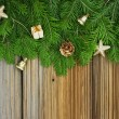 Christmas background: fir-tree branches with Christmas tree deco — Stock Photo