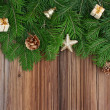 Christmas background: fir-tree branches with Christmas tree deco — Stock Photo #33900557