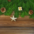 Christmas background: fir-tree branches with Christmas tree deco — Stockfoto